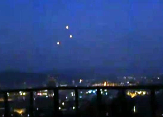 Latest UFO Sightings Orange UFO's Captured Hovering Motionless