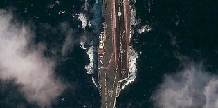 EXPOSED! Satellite Photo Reveals China's First Aircraft Carrier At Sea