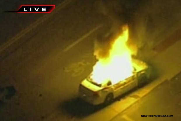 ferguson-protesters-set-police-car-on-fire
