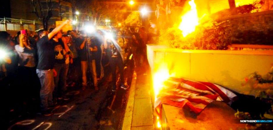 honduran-migrants-burn-american-flag-george-soros