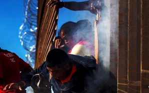caravan-migrants-rush-us-border-attack-guards-with-projectiles