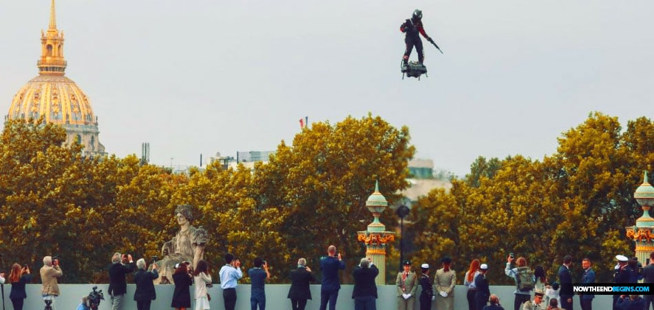 French inventor soars above Champs-Élysées on flyboard at Paris parade